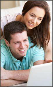 smiling-couple-on-computer-dT-17068522_Couple.jpg
